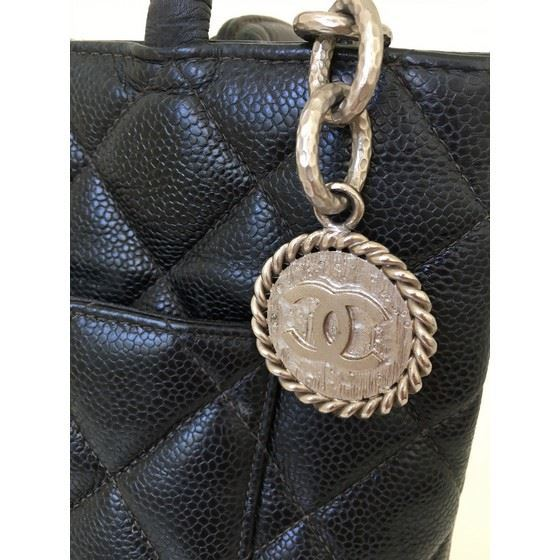 a74cc27b54b167 Vintage and Musthaves. CHANEL Black Caviar Skin CC Charm MEDALLION ...